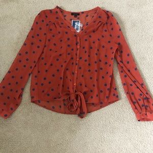 Blood Orange with blue polka dotted blouse